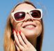 woman wearing sunglasses smiling