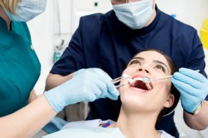 woman smiling getting dental checkup
