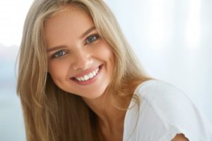 woman blonde hair smiling nice teeth